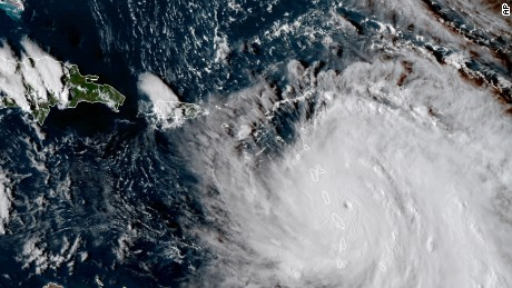 This Monday, Sept. 18, 2017, GOES East satellite image provided by NASA taken at 20:30 UTC, shows the eye of Hurricane Maria as it nears Dominica. The National Hurricane Center in Miami said Monday evening that Air Force Reserve hurricane hunter planes found that Maria had strengthened into a storm with 160 mph (260 kph) winds. (NASA via AP)