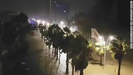 "This handout picture released on September 19, 2017, on the Instagram account of ""loly_fwi"" shows the powerful winds and rain of hurricane Maria battering the Faidherbe boulevard along the City House (L) of Pointe-a-Pitre on the French overseas Caribbean island of Gaudeloupe.