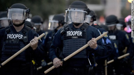 September 17, 2017 - St. Louis, United States - Dozens of St. Louis riot police armed with batons march toward a large group of protesters on Olive Street. Demonstrators briefly clashed with riot police, but the official protest was largely peaceful on September 17, 2017 in St. Louis, Missouri. Dozens of business windows were smashed and at least two police cars were damaged during a second day of protests following the acquittal of Stockley, who was been charged with first-degree murder last year following the 2011 on-duty shooting of Anthony Lamar Smith.