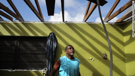CHARLOTTE AMALIE, ST THOMAS, US VIRGIN ISLANDS - SEPTEMBER 18:  Carmelo Mota searches for tools in his destroyed bedroom more than a week after Hurricane Irma made landfall September 18, 2017 in Charlotte Amalie, St Thomas, U.S. Virgin Islands. Mota is a builder and said that Irma's ferocious strength has made him completely rethink how he will construct houses in the future. With sustained winds at 150mph, Irma blew completely through the Tutu High Rise building, killing one woman when she was sucked out of her apartment. Hurricane Irma slammed into the Leeward Islands on September 6 as a Category 5 storm, killing four and causing major damage on the islands of St. John and St. Thomas.  (Photo by Chip Somodevilla/Getty Images,)