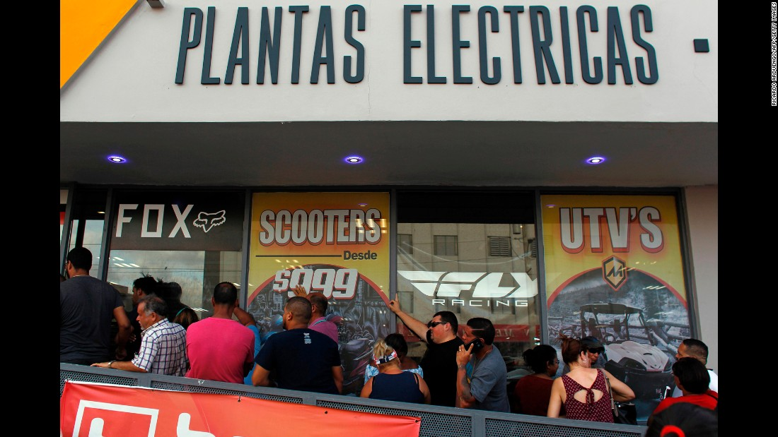Customers wait in line for power generators at a store in San Juan, Puerto Rico