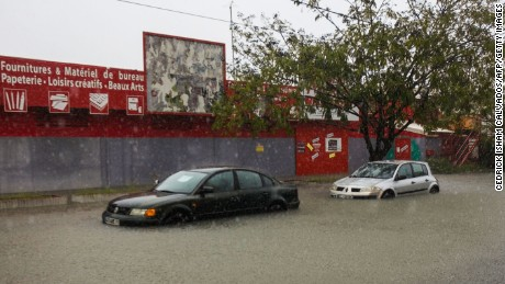 "Flooded cars  are pictured in the Lauricisque district of Pointe-a-Pitre on September 19, 2017 in the French territory of Guadeloupe, after the passage of Hurricane Maria. Hurricane Maria headed towards the Virgin Islands and Puerto Rico on September 19, with the US National Hurricane Center warning of a ""potentially catastrophic"" impact as it battered the eastern Caribbean. Arriving just as islanders in the region are struggling to recover from devastating Hurricane Irma which struck earlier this month, Maria claimed its first victim in the French territory of Guadeloupe, where two other people were missing.  / AFP PHOTO / Cedrick Isham CALVADOSCEDRICK ISHAM CALVADOS/AFP/Getty Images"