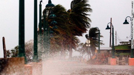 "Winds lash the coastal city of Fajardo as Hurricane Maria approaches Puerto Rico, on September 19, 2017.  Maria headed towards the Virgin Islands and Puerto Rico after battering the eastern Caribbean island of Dominica, with the US National Hurricane Center warning of a ""potentially catastrophic"" impact. / AFP PHOTO / Ricardo ARDUENGO        (Photo credit should read RICARDO ARDUENGO/AFP/Getty Images)"