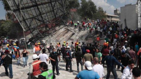 Rescue workers and volunteers search a building that collapsed after an earthquake in the Roma neighborhood of Mexico City, Tuesday, Sept. 19, 2017. A powerful earthquake jolted central Mexico on Tuesday, causing buildings to sway sickeningly in the capital on the anniversary of a 1985 quake that did major damage. (AP Photo/Eduardo Verdugo)