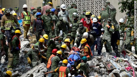 A man is pulled out of the rubble alive in Mexico City on September 20.