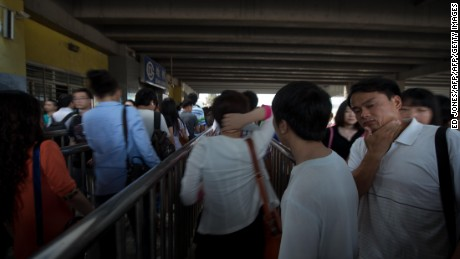 Commuters wait to enter a subway station during the morning rish hour in Beijing on June 19, 2013. Despite some five million private vehicles in Beijing, public transport faces heavy congestion on a daily basis as most of the city's 20 million people head to work. AFP PHOTO / Ed Jones        (Photo credit should read Ed Jones/AFP/Getty Images)