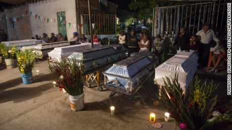 Mandatory Credit: Photo by Francisco Guasco/EPA-EFE/REX/Shutterstock (9068265d) Residents mourn eleven people who were killed during the earthquake in the  town of Atzala, in the state of Puebla, Mexico, 20 September 2017. Eleven people died in a church during a baptism at the time of the earthquake. At least 224 people have died in the states of Morelos, Puebla and Mexico following a powerful 7.1 earthquake that struck central Mexico. Mexico earthquake aftermath, Atzala - 20 Sep 2017
