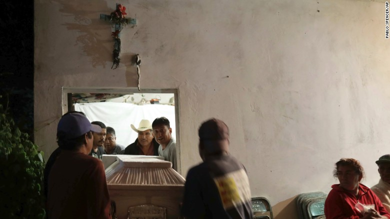 Residents carry the casket of one of the victims.