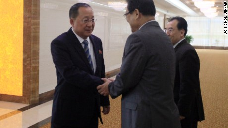 North Korean Foreign Minister Ri Yong Ho, left, shakes hands with North Korean Vice Foreign Minister Pak Myong Guk as he leaves the Pyongyang Airport, North Korea Tuesday, Sept. 19, 2017. Ri flew out of Pyongyang Tuesday morning to go to New York for the U.N. General Assembly. (AP Photo/Jon Chol Jin)