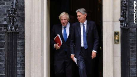 UK Chancellor of the Exchequer Philip Hammond, right, departs 10 Downing Street with UK Foreign Secretary Boris Johnson after a Cabinet meeting on Thursday.