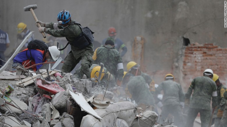 "Rescue workers search for survivors Thursday, September 21, at a collapsed apartment building in Mexico City. A magnitude 7.1 quake <a href=""http://www.cnn.com/interactive/2017/09/world/mexico-quake-cnnphotos/"" target=""_blank"">hit central Mexico</a> two days earlier."