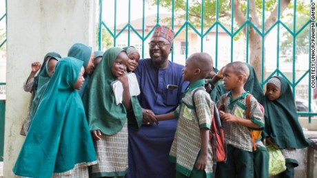 Zannah Mustapha with some of the children from his Future Prowess Islamic Foundation School.
