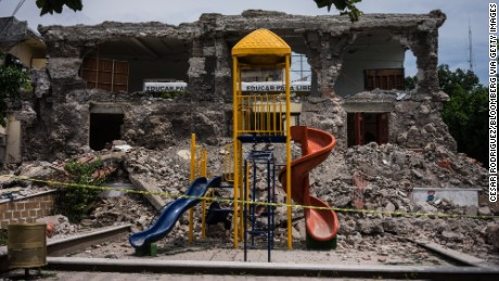 The playground of a collapsed school stands in the town of Jojutla de Juarez, Morelos State, Mexico, on Wednesday, Sept. 20, 2017. The 7.1 magnitude earthquake destroyed dozens of buildings and killed at least 225 people, with an unknown number still missing. Photographer: Cesar Rodriguez/Bloomberg via Getty Images