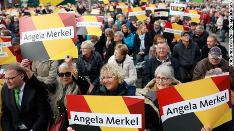 Merkel supporters wave placards at a campaign rally in Kappeln, Germany on September 20.