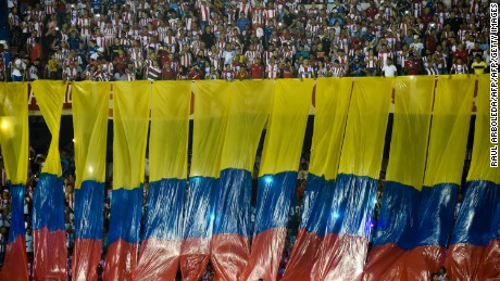 Supporters of Colombia's Atletico Junior cheer for their team before the start of their Copa Sudamericana football match againts Paraguay's Cerro Porteno at Roberto Melendez stadium in Barranquilla, Colombia on September 19, 2017. / AFP PHOTO / RAUL ARBOLEDA        (Photo credit should read RAUL ARBOLEDA/AFP/Getty Images)