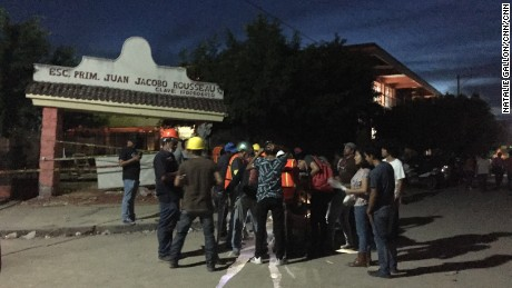 A search-and-rescue team in Jojutla gathers.