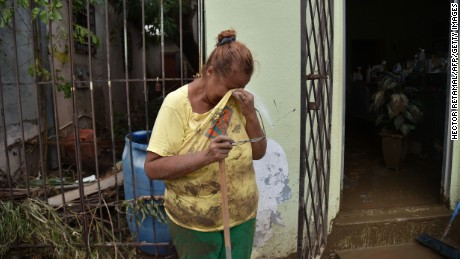 Gloria Lynn cries next to a salon that was flooded after the rains related to the passage of Hurricane Maria, in Toa Baja, Puerto Rico, on September 22.