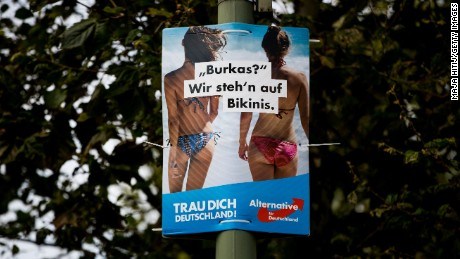 "A poster from the far-right Alternative for Germany on September 21 in Berlin, Germany, that reads ""Burkas? We prefer bikinis""."