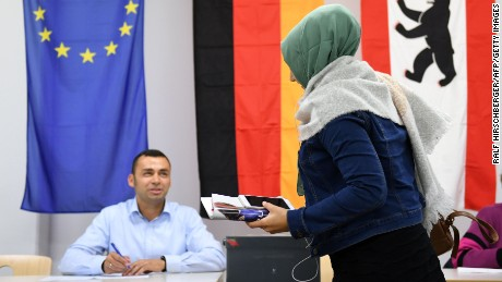 A woman wearing a veil casts her ballot at a polling station in Berlin during general elections on September 24.
