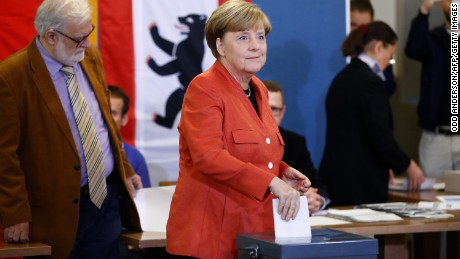 German Chancellor Angela Merkel vows to forge stable government despite diminished win