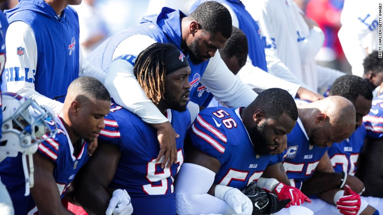 Buffalo Bills players kneel during the American national anthem before an NFL game on Sunday.