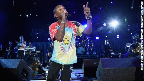 "Pharrell performs with The Roots at ""A Concert for Charlottesville,""  at University of Virginia's Scott Stadium on September 24, 2017 in Charlottesville, Virginia. Concert live-stream presented in partnership with Oath.  (Photo by Kevin Mazur/Getty Images)"