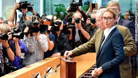 Joerg Meuthen (R, hidden), co-leader of Germany's nationalist Alternative for Germany (AfD) party, AfD top candidate Alexander Gauland (3rd R) and AfD top candidate Alice Weidel (2nd R) arrive for a press conference of the AfD in Berlin on September 25, 2017, one day after general elections.