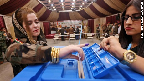 A female members of a Kurdish Peshmerga battalion casts her vote in the Kurdish independence referendum in Arbil, on September 25, 2017. 