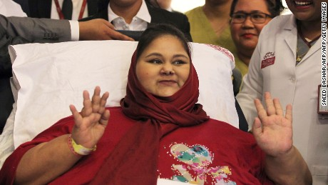 Egyptian national Eman Ahmed Abd El Aty waves during a press conference on July 24, 2017 at the Burjeel Hospital in Abu Dhabi where she is receiving treatment following drastic weight-loss surgery. Aty once believed to be the 'world's heaviest woman' arrived in Abu Dhabi from India earlier in the year to continue to her treatment.  / AFP PHOTO / Saeed BASHAR        (Photo credit should read SAEED BASHAR/AFP/Getty Images)
