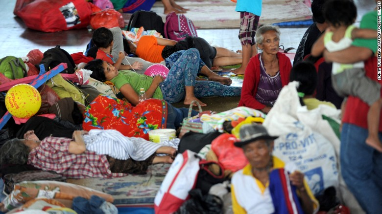 Villagers rest after being evacuated during the raised alert levels for the volcano on Mount Agung on September 22, 2017.