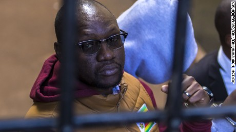 Zimbabwean cleric and political activist Evan Mawarire arrives at the magistrate's court in Harare on June 28 2017 after he was detained for addressing and praying with striking University of Zimbabwe medical students. Zimbabwean pastor and political activist Evan Mawarire was freed on $200 bail on June 28, 2017 after his arrest for speaking to striking medical students. / AFP PHOTO / Jekesai NJIKIZANA        (Photo credit should read JEKESAI NJIKIZANA/AFP/Getty Images)