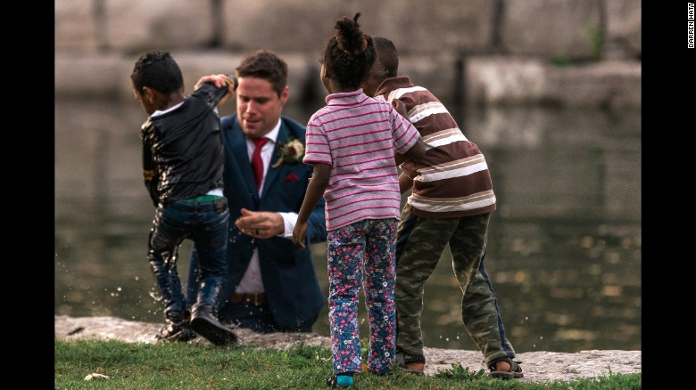 Groom rescues boy from water during wedding photo session