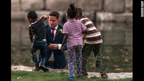 Newlywed Clayton Cook interrupted his wedding photography session to rescue a drowning child. Courtesy: Hatt Photography