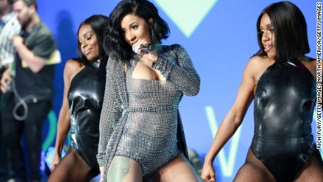 Cardi B, center, performs during the 2017 MTV Video Music Awards on August 27, 2017 in Inglewood, California.