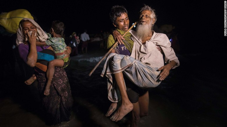 Hundreds of Rohingya arrive in Bangladesh by boat under cover of darkness on September 26, 2017.