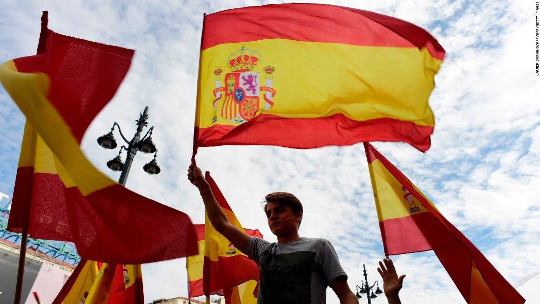 People attend a demonstration against a referendum on independence for Catalonia on Sunday, October 1, 2017 in Madrid, Spain.