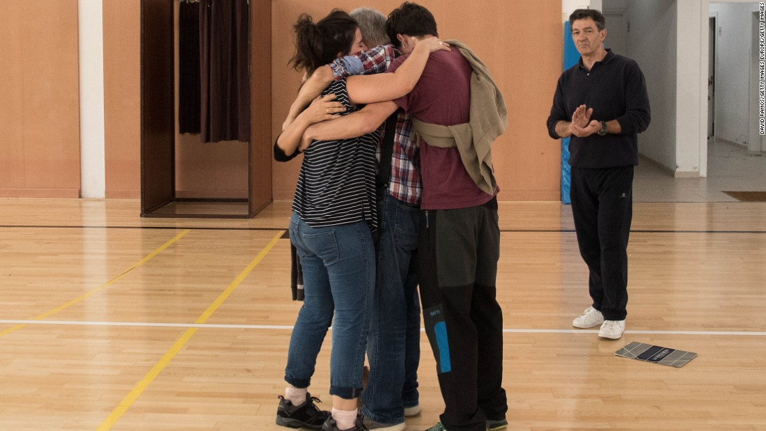 Family members comfort each other after they were unable to vote in the referendum after Spanish police closed their polling station on Sunday, October 1, 2017 in Sant Julia de Ramis, Spain.