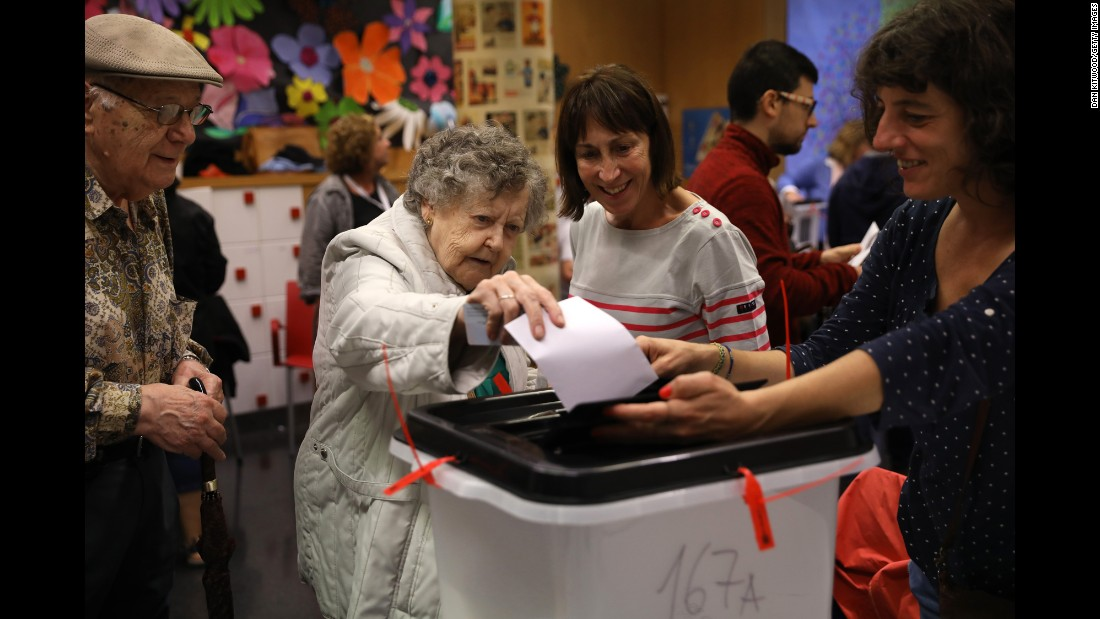 A woman casts her vote at a polling station in Barcelona.