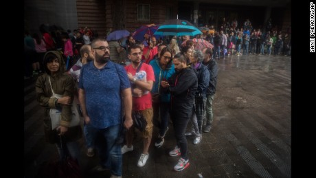 People queue to vote in the banned referendum on Catalonia's independence.