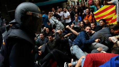 Spanish National Police clash with pro-independence supporters in Barcelona on October 1.