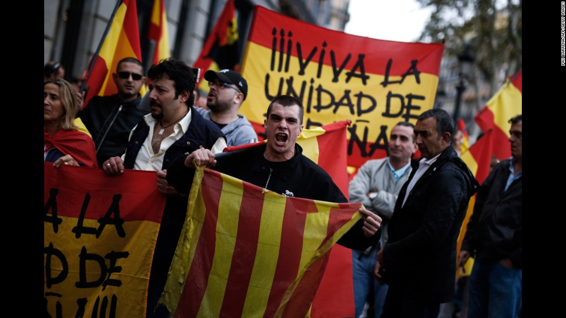 A protestor shouts as he holds a Catalan flag during a demonstration called by far-right groups in Barcelona.