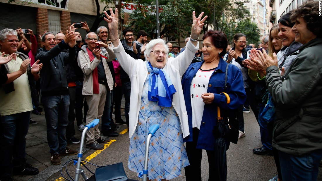 A woman celebrates after voting at a polling station in Barcelona on October 1.
