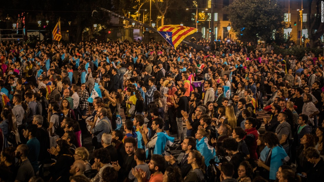 Independence supporters gather in Barcelona's Plaza Catalonia Sunday night.