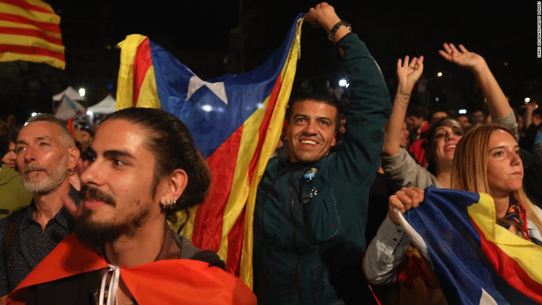People await the referendum's result on Sunday in Barcelona.