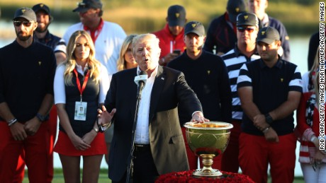 U.S. President Donald Trump presents the U.S. Team with the trophy after they defeated the International Team 19 to 11