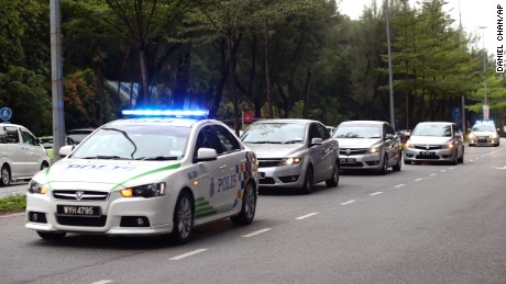Police cars carrying the two suspects enter the Shah Alam court house outside Kuala Lumpur Malaysia on Monday Oct. 2