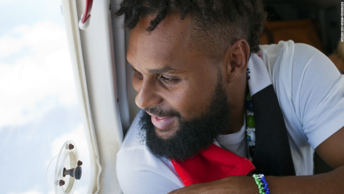 Australian NBA star Patty Mills looks out of the plane as he heads to his ancestral home of Mer off the northern coast of Australia.