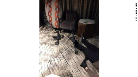 Leaked photos published by the Daily Mail show the scene, including what appears to be the the shooter's body, inside Stephen Paddock's room at the Mandalay Bay in Las Vegas.