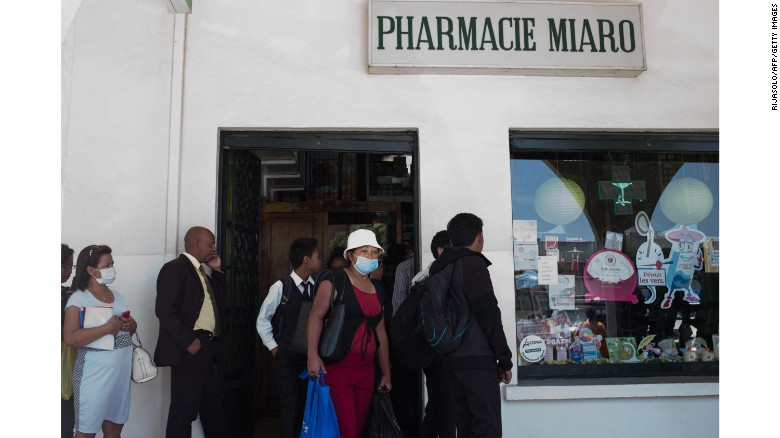 People line up at a pharmacy in downtown Antananarivo.