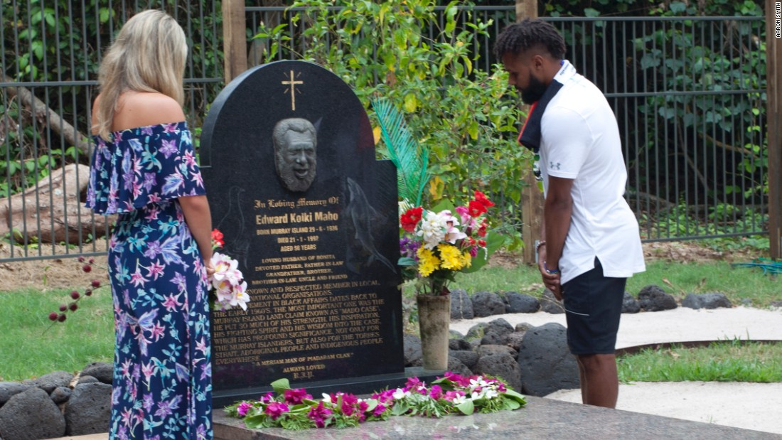 Patty Mills and his partner Alyssa Levesque visit Eddie Mabo's grave on Mer.